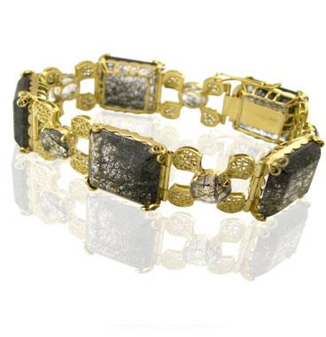 pulseira de ouro com pedras preciosas