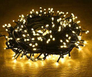 Luz Natalina Amarela 100 LEDs 10M 220V Cordão Verde - Aprova D'água