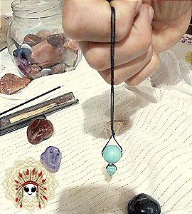 Pêndulo de cristal e pedras