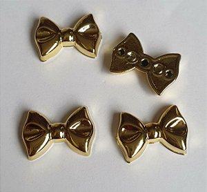 Aplicação ABS Laço gravata dourado - Tamanho: 25mm X 12mm - Embalagem com 6 unidades
