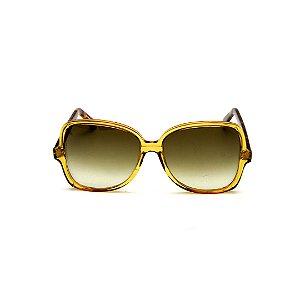 Óculos de Sol Gustavo Eyewear G110 2. Cor: Âmbar translúcido. Haste animal print. Lentes marrom.