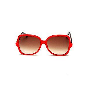 Óculos de Sol Gustavo Eyewear G110 3. Cor: Vermelho opaco. Haste animal print. Lentes marrom.