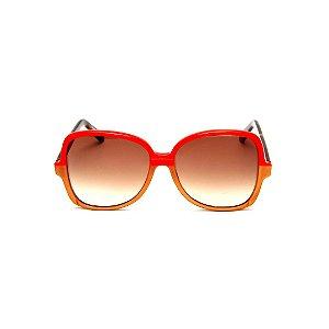 Óculos de Sol Gustavo Eyewear G110 7. Cor: Vermelho e caqui opaco. Haste animal print. Lentes marrom.