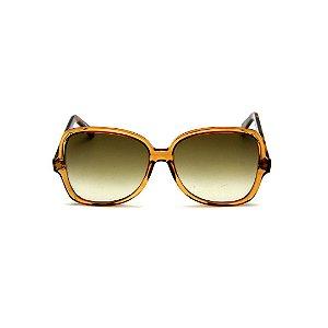 Óculos de Sol Gustavo Eyewear G110 14. Cor: Caramelo translúcido. Haste animal print. Lentes marrom.