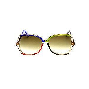 Óculos de Sol Gustavo Eyewear G110 15. Cor: Âmbar, azul, verde, preto e vermelho. Hastes verdes e azuis. Lentes verdes.