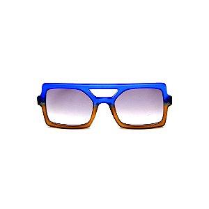 Óculos de Sol Gustavo Eyewear G114 3. Cor: Azul e caramelo translúcido. Haste animal print. Lentes cinza.