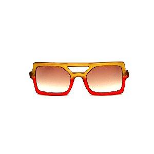 Óculos de Sol Gustavo Eyewear G114 8. Cor: Caramelo e vermelho translúcido. Haste animal print. Lentes marrom.