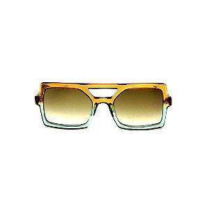 Óculos de Sol Gustavo Eyewear G114 13. Cor: Caramelo e acqua translúcido. Haste animal print. Lentes verdes.