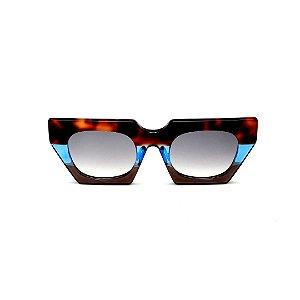 Óculos de Sol Gustavo Eyewear G137 2. Cor: Animal print, azul e marrom translúcido. Haste animal print. Lentes cinza.