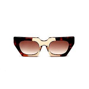 Óculos de Sol Gustavo Eyewear G137 4. Cor: Animal print e âmbar translúcido. Haste animal print. Lentes marrom.