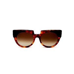 Óculos de Sol Gustavo Eyewear G135 6. Cor: Animal print e preto. Haste animal print. Lentes marrom.