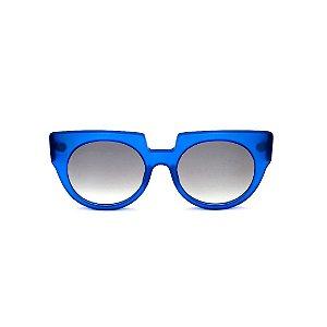 Óculos de Sol Gustavo Eyewear G135 5. Cor: Azul translúcido. Haste animal print. Lentes cinza.