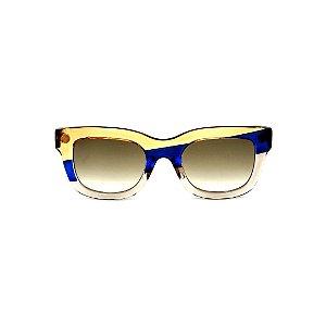 Óculos de Sol Gustavo Eyewear G57 5. Cor: Âmbar, azul e fumê translúcido. Haste preta. Lentes cinza.