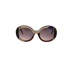 Óculos de Sol Gustavo Eyewear G61 16. Cor: Fumê, vermelho, preto e azul translúcidos. Haste preta. Lentes cinza.