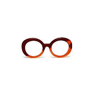 Armação para óculos de Grau Gustavo Eyewear G61 200. Cor: Vermelho com laranja translúcido. Haste animal print.