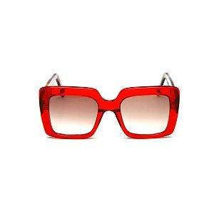 Óculos de sol Gustavo Eyewear G59 4. Cor: Vermelho translúcido. Haste animal print.
