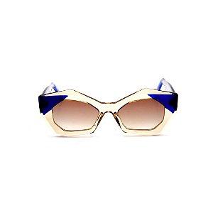 Óculos de sol Gustavo Eyewear G92 8. Cor: Âmbar e azul translúcido. Haste azul. Lentes marrom.