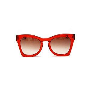 Óculos de sol Gustavo Eyewear G75 3. Cor: Vermelho translúcido. Haste animal print. Lentes marrom.