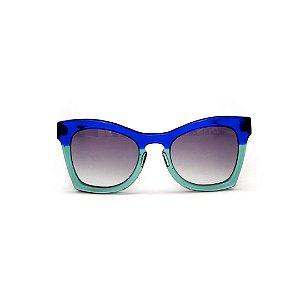 Óculos de sol Gustavo Eyewear G75 6. Cor: Azul translúcido e acqua. Haste azul. Lentes cinza.