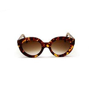 Óculos de sol Gustavo Eyewear G25 6. Cor: Animal print. Haste animal print. Lentes marrom.