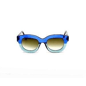 Armação para óculos de Grau Gustavo Eyewear G12 2. Cor: Azul e acqua. Haste preta. Lentes marrom.
