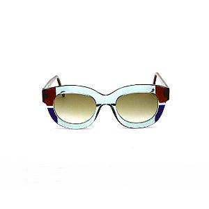 Armação para óculos de Grau Gustavo Eyewear G12 3. Cor: Acqua, azul e marrom. Haste marrom. Lentes marrom.
