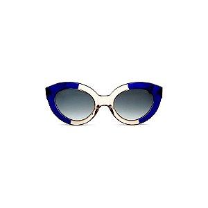 Óculos de sol Gustavo Eyewear G25 10. Cor: Azul translúcido e âmbar. Haste azul. Lentes marrom.