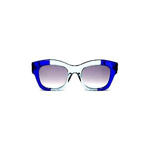 Óculos de Sol Gustavo Eyewear G58 11. Cor: Azul bic a acqua translúcido. Haste preta. Lentes cinza.