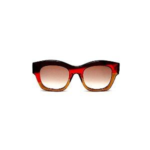 Óculos de Sol Gustavo Eyewear G58 12. Cor: Marrom, vermelho e caramelo translúcido. Haste marrom. Lentes marrom.