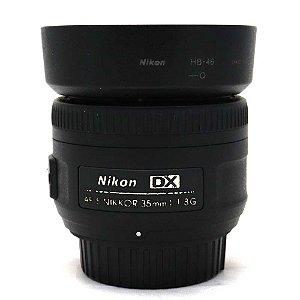 Lente Nikon NIKKOR AF-S 35mm f/1.8G DX Usada com Parasol