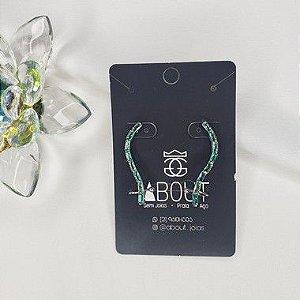 Brinco Ear Cuff com zircônia verdes banhado em ródio branco