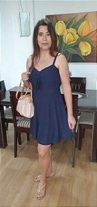 Vestido em malha lese de alça e amarração frontal. Na cor azul marinho.