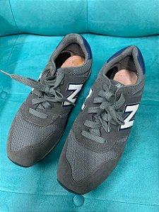 Tênis New Balance Cinza