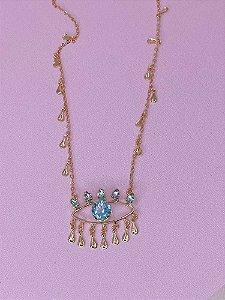 Colar Olho Grego dourado com pedrinhas lilás e azul claro