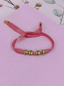 Pulseira tecido rosa com escrita LIFE dourado