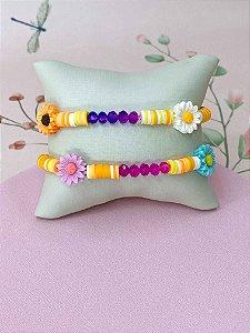 Pulseira Rainbow com detalhes laranja e margaridas coloridas