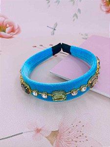 Arco veludo azul com pedras coloridas