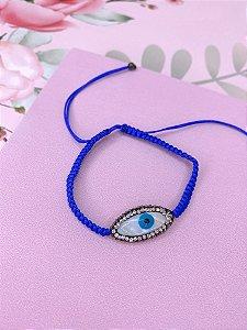 Pulseira tecido azul de olho grego com strass