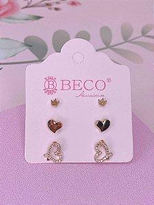 Brinco trio coroa, coração e coração vazado com strass - prata ou dourado