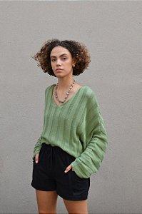 Blusa de tricot manga morcego e decote