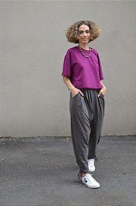 Calça saruel de malha com bolso e amarração perna