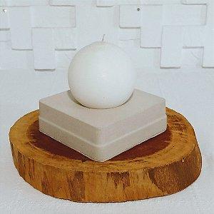 Castiçal de cimento com vela redonda