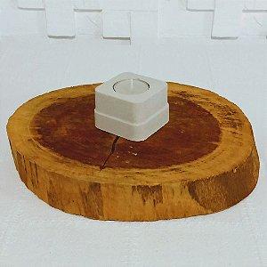 Castiçal de cimento com vela de rechaud