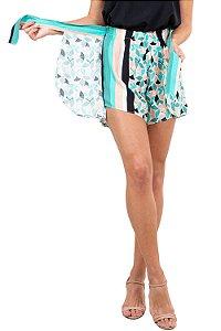 Shorts curto tranpassado com amarração estampado