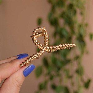 Piranha de cabelo metal torcido dourado