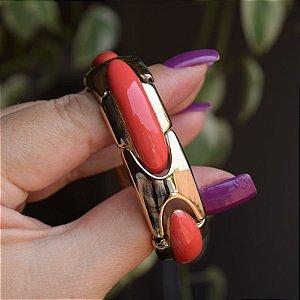 Bracelete metal esmaltado coral com dourado
