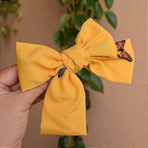Presilha laço borboletas amarelo