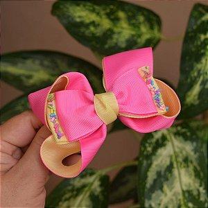 Presilha bico de pato infantil laço rosa com amarelo