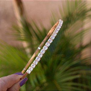 Tiara metal dourado com cristais redondos