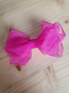 Laço sobreposto pink